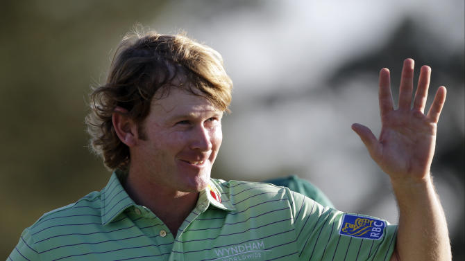 Brandt Snedeker waves to the gallery on the 18th hole after finishing the third round of the Masters golf tournament Saturday, April 13, 2013, in Augusta, Ga. (AP Photo/David Goldman)