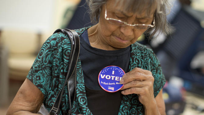 Aida Castillo places a sticker on her blouse indicating that she had voted during the early voting period, Saturday, Oct. 20, 2012, in Las Vegas. In the heavily-Hispanic neighborhoods of Las Vegas, unemployment is high and home values are down. But President Barack Obama's immigration stand has locked in support from a fast-growing demographic group that has been trending sharply Democratic in the wake of increasingly hard-line Republican positions on immigration. Part of the reason is his executive order that allows people brought into the country illegally as children to avoid deportation if they graduate high school or join the military. The president's campaign is counting on Hispanics providing the margin of victory not just in Nevada, but in other swing states such as Colorado, Iowa, Virginia and North Carolina. (AP Photo/Julie Jacobson)