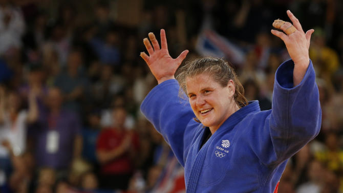 Britain's Karina Bryant celebrates after winning her women's  78kg bronze medal judo match against Ukraine's Iryna Kindzerska at the London 2012 Olympic Games