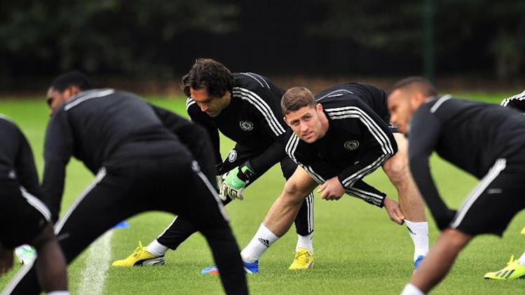 File photo shows Chelsea's Gary Cahill warming up with teammates during a training session in Stoke D'Abernon, south London, on September 17, 2013