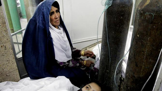 An Afghan school girl receives treatment after becoming ill, at a hospital in Kabul, Afghanistan, Wednesday, May 1, 2013. Amanullah Eman, a spokesman for the Education Ministry, said some students were briefly hospitalized but all were doing well. He said a number of factors were being investigated, including the use of fertilizers in nearby farm land. (AP Photo/Ahmad Jamshid)