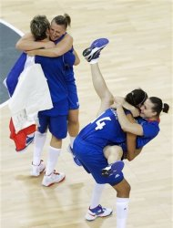 From left, France's players Celine Dumerc, Florence Lepron, Emmeline Ndongue and Clemence Beikes celebrate after defeating Russia in a women's basketball semifinal game at the 2012 Summer Olympics, Thursday, Aug. 9, 2012, in London. (AP Photo/Victor R. Caivano)