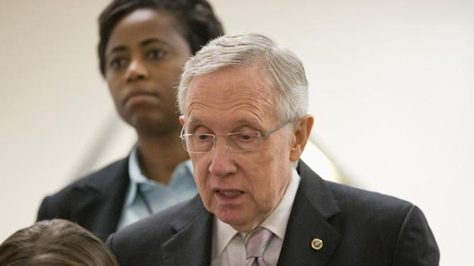 Senate Majority Leader Harry Reid of Nev. walks to a closed-door briefing by national security officials on the situation in Syria, Friday, Sept. 6, 2013, on Capitol Hill in Washington. President Barack Obama has requested congressional authorization for military intervention in Syria in response to last month's alleged sarin gas attack in the Syrian civil war. (AP Photo/J. Scott Applewhite)