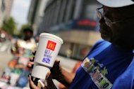 File picture shows a customer with an extra large soft drink from in New York City. New York became the first city in the United States to impose a limited ban on super-sized soda drinks blamed by Mayor Michael Bloomberg for fueling a national obesity crisis