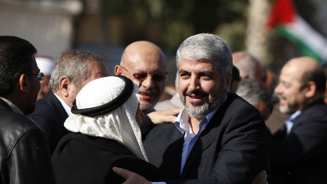 Exiled Hamas chief Khaled Mashaal upon his arrival at Rafah crossing in the southern Gaza Strip, Friday, Dec. 7, 2012. The exiled Hamas chief broke into tears Friday as he arrived in the Gaza Strip for his first-ever visit, a landmark trip reflecting his militant group's growing international acceptance and its defiance of Israel. Khaled Mashaal, who left the West Bank as a child and leads the Islamic militant movement from Qatar, crossed the Egyptian border, kissed the ground, and was greeted by a crowd of Hamas officials and representatives of Hamas' rival Fatah party. He was also welcomed by a group of Palestinian orphans — children of Gaza militants killed by Israel in recent years — wearing military-style uniforms. (AP Photo/Suhaib Salem , Pool)