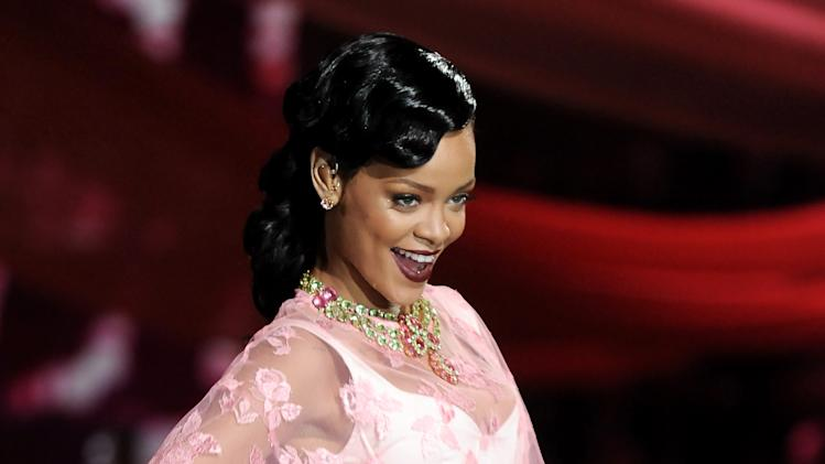 "FILE - This Nov. 7, 2012 file photo shows singer Rihanna during the 2012 Victoria's Secret Fashion Show in New York. Rihanna has signed on to executive produce the new series ""Styled to Rock"" for the Style network. The 10-episode series set to air in 2013 will give 12 aspiring designers, chosen by Rihanna, an opportunity to style A-list stars. (Photo by Evan Agostini/Invision/AP, file)"