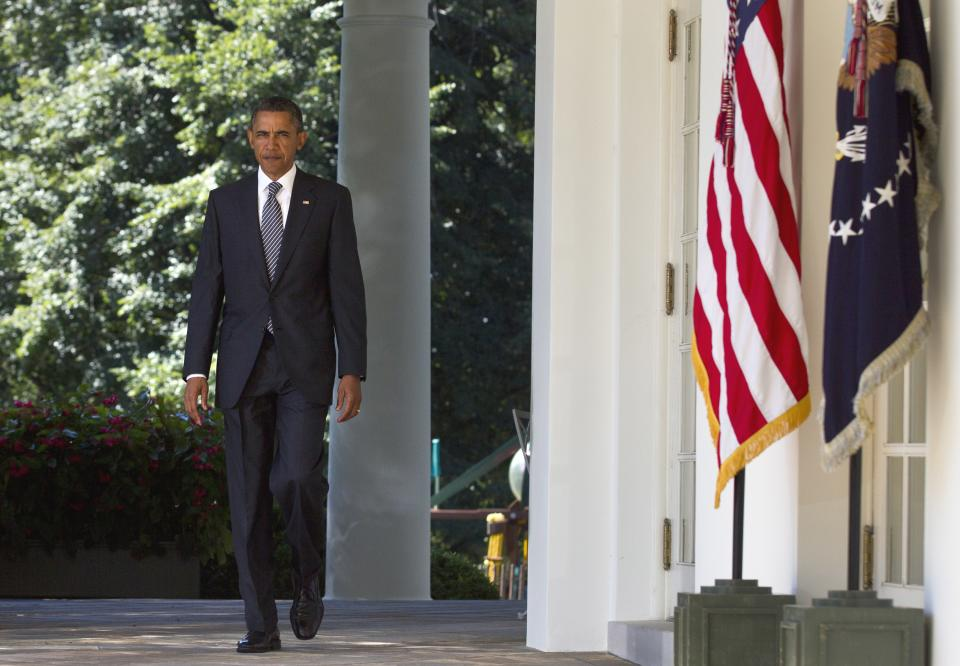 President Barack Obama walks to the Rose Garden of the White House in Washington, Wednesday, Aug. 31, 2011, where he urged Congress to pass a federal highway bill. (AP Photo/Carolyn Kaster)