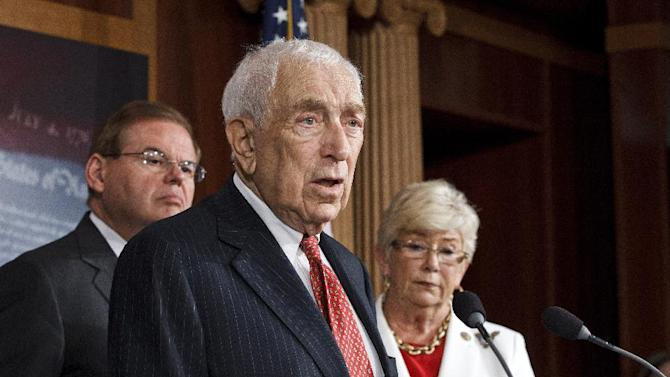 Sen. Frank Lautenberg, D-N.J., center, leads a news conference on Capitol Hill in Washington, Tuesday, July 24, 2012, to criticize the sale of high-capacity magazines for assault rifles that are sold to the public. He is joined by Sen. Robert Menendez, D-N.J., left, and Rep. Carolyn McCarthy, D-N.Y., right. A previous federal ban on high-capacity ammunition magazines was allowed to lapse in 2004.  (AP Photo/J. Scott Applewhite)