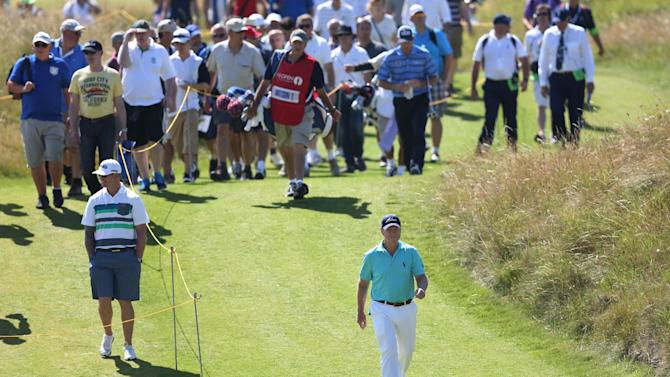 Tom Watson of the US walks up to the 13th green during the first day of the British Open Golf championship at the Royal Liverpool golf club, Hoylake, England, Thursday July 17, 2014. (AP Photo/Scott Heppell)