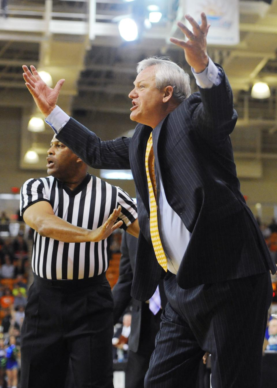 Mercer coach Bob Hoffman makes a point to the officials during an NCAA college basketball game against Florida Gulf Coast for the Atlantic Sun men's tournament championship, in Macon, Ga., Saturday, March 9, 2013. Florida Gulf Coast won 88-75. (AP Photo/Woody Marshall)
