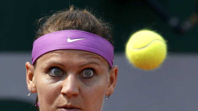 Lucie Safarova of the Czech Republic plays a shot to Kurumi Nara of Japan during their women's singles match at the French Open tennis tournament at the Roland Garros stadium in Paris