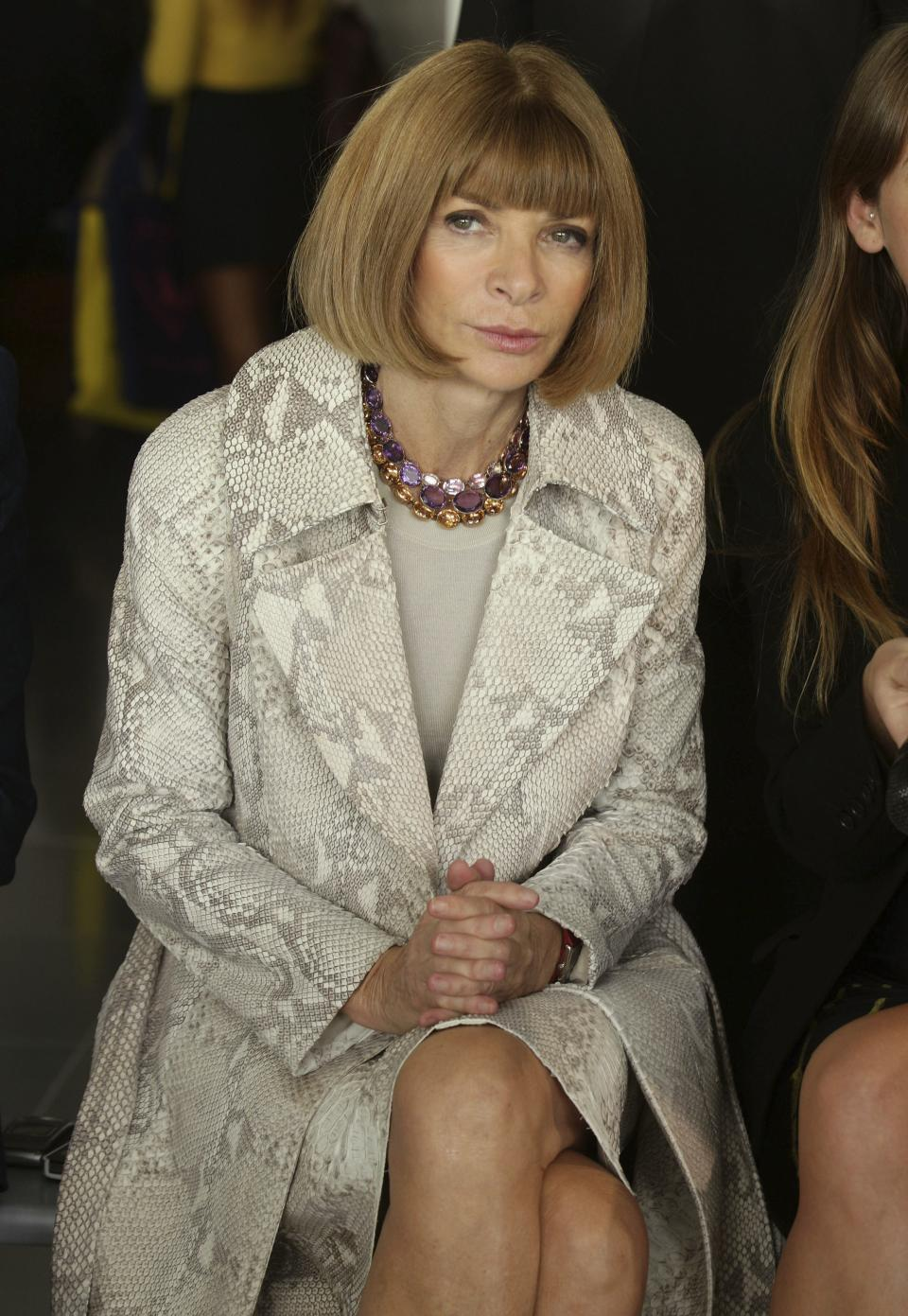 English born editor-in-chief of American Vogue, Anna Wintour attends the Christopher Kane spring/summer 2013 show, during London Fashion Week, at Park House in central London, Monday Sept.17, 2012. (AP Photo/Yui Mok/PA) UNITED KINGDOM OUT