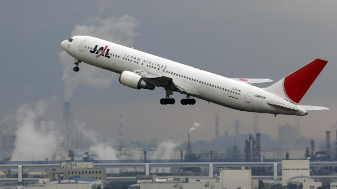 Japan Airlines passenger plane takes off at Haneda Airport in Tokyo, Monday, Feb. 4, 2013.   Japan Airlines, which made a comeback from bankruptcy, says its net profit fell 3.7 percent in the first three quarters of 2012, but the carrier shrugged off the impact from its grounded 787s, raising its full-year profit estimate. (AP Photo/Koji Sasahara)