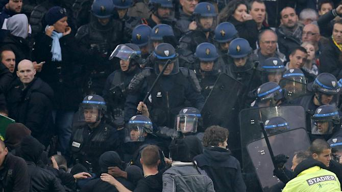 Anti-riot policemen arrive in the tribune before the French Ligue 1 soccer match between Paris St Germain and FC Nantes at the Beaujoire stadium in Nantes