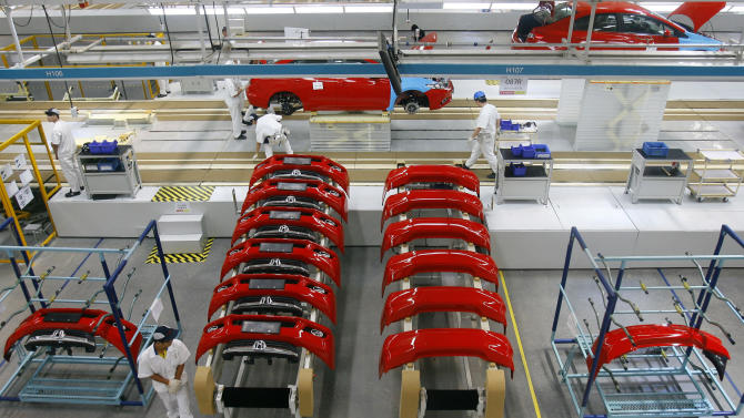 In this photo taken Tuesday July 10, 2012, Chinese workers assemble cars at a plant of Dongfeng Honda, a joint venture between China's Dongfeng Motor and Japan's Honda Motor in Wuhan in central China's Hubei province. Auto sales in China rose 9 percent in June despite a slowing economy as buyers rushed to beat possible efforts to curb traffic jams by limiting registrations, data showed Wednesday, July 11, 2012. (AP Photo) CHINA OUT