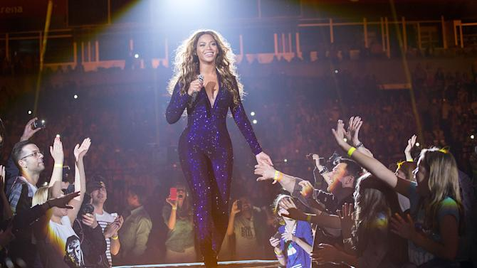 """Singer Beyonce performs on the opening night of her """"Mrs. Carter Show World Tour 2013"""", on Monday, April 15, 2013 at the Kombank Arena in Belgrade, Serbia. Beyonce is wearing a cobalt blue hand beaded jumpsuit by designer Vrettos Vrettakos. (Photo by Yosra El-Essawy/Invision for Parkwood Entertainment/AP Images)"""
