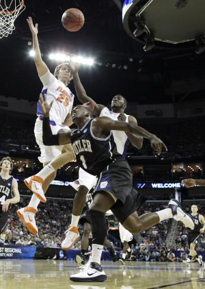Butler's Shelvin Mack (1) shoots past Florida's Chandler Parsons (25) and Florida's Patric Young during the first half of the NCAA Southeast regional college basketball championship game Saturday, March 26, 2011, in New Orleans. (AP Photo/David J. Phillip)