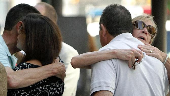 People hug before attending a memorial service at the Pennsylvania Academy of the Fine Arts in Philadelphia, on Sunday, June 9, 2013. The service was for Anne Bryan, who was among the victims of a fatal building collapse in Philadelphia last Tuesday.  (AP Photo/Joseph Kaczmarek)
