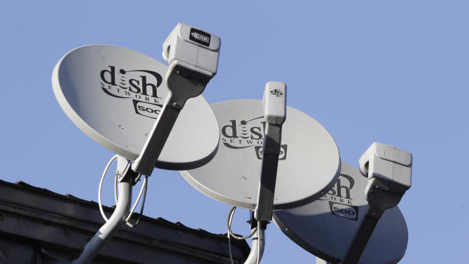 FILE - In this Feb. 23, 2011 file photo, three Dish Network satellite dishes are shown at an apartment complex in Palo Alto, Calif. Dish Network Corp., the nation's second-largest satellite TV broadcaster, on Monday May 2, 2011, reported that its first-quarter net income more than doubled, helped by a patent settlement with TiVo Inc.(AP Photo/Paul Sakuma)