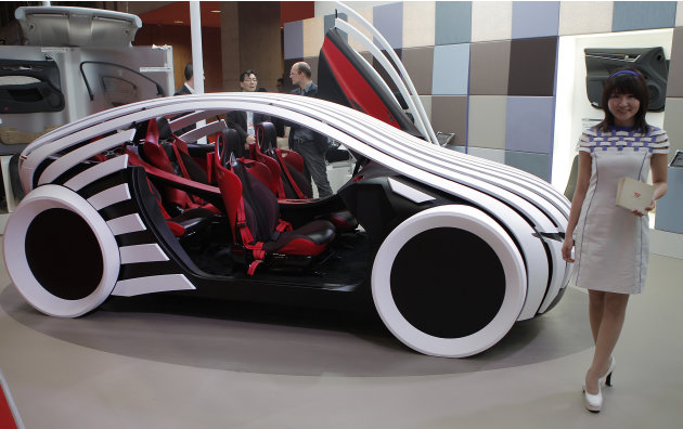 Toyota Boshoku Corp.'s concept vehicle T-Brain is displayed during the press preview of Tokyo Motor Show in Tokyo, Wednesday, Nov. 30, 2011. The Tokyo Motor Show opens to the public this weekend. (AP