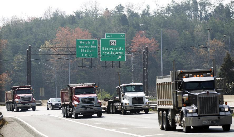 Northbound vehicles drive on Interstate 270 past the exit to Hyattstown, Md. Friday, March 23, 2012.   Maryland State Police say an armored truck lost some cash on I-270 near Hyattstown.   (AP Photo/Manuel Balce Ceneta)