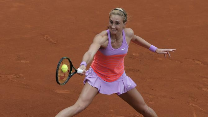 Petra Martic of Croatia plays a shot to Garbine Muguruza of Spain during the women's singles match at the French Open tennis tournament at the Roland Garros stadium in Paris