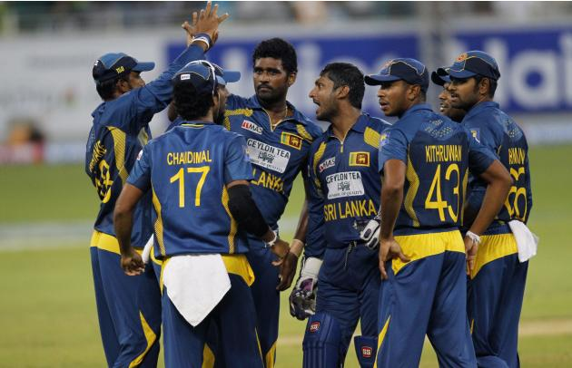 Sri Lanka's Thisara Perera celebrates with his team mates the wicket of Pakistan's Sohaib Maqsood during their second Twenty20 international cricket match in Dubai