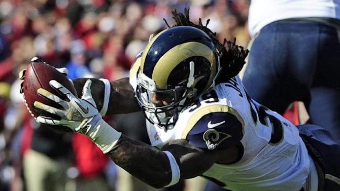 St. Louis Rams running back Steven Jackson (39) dives over the goal to score against the Tampa Bay Buccaneers during the second quarter of an NFL football game on Sunday, Dec. 23, 2012, in Tampa, Fla. (AP Photo/Brian Blanco)