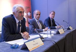 Global airline executives address reporters at the…