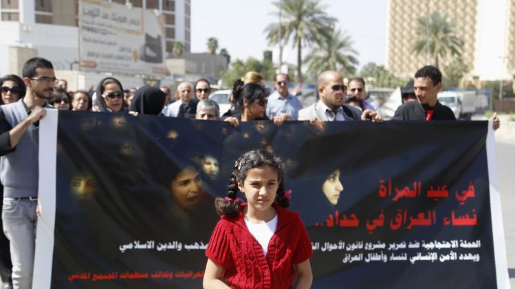 "Protesters take part in a demonstration against the draft of the ""Al-Jafaari"" Personal Status Law during International Women's Day in Baghdad"