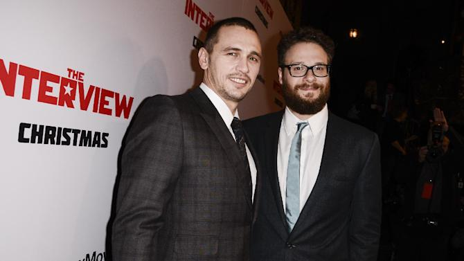 "FILE - In this Dec. 11, 2014 file photo, actors Seth Rogen, right, and James Franco attend the premiere of the Sony Pictures' film ""The Interview"" in Los Angeles. Celebrities react to Sony's announcement Wednesday, Dec. 24, 2014, that it released Rogen and Franco's North Korea satire, ""The Interview,"" on digital platforms: ""You wanna watch The Interview?? You can RIGHT ... NOW!! ... Thanks Sony for making it happen. Booyah."" - Rogen on Twitter moments after ""The Interview"" became available.  ""Merry X-mas MERICA!  !!!!!THE INTERVIEW IS LIVE!!!!!! !!! ...  Thank you SONY!!!!!!!!"" - Franco on Twitter shortly after ""The Interview"" became available. (Photo by Dan Steinberg/Invision/AP Images, File)"