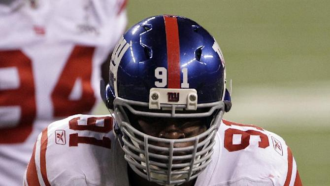 New York Giants defensive end Justin Tuck (91) reacts after sacking New England Patriots quarterback Tom Brady during the second half of the NFL Super Bowl XLVI football game, Sunday, Feb. 5, 2012, in Indianapolis. The Giants won 21-17. (AP Photo/David Duprey)