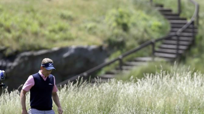 Luke Donald, of England, walks down the 17th hole during the second round of the U.S. Open golf tournament at Merion Golf Club, Friday, June 14, 2013, in Ardmore, Pa. (AP Photo/Morry Gash)