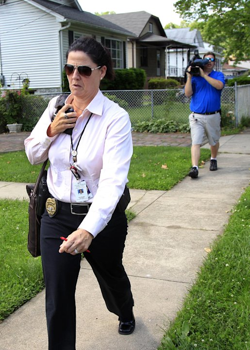 An investigator with the Camden County prosecutors office leave a residence in Maple Shade, N.J., Thursday, May 24, 2012. A woman who answered the door said that it is the home of Pedro Hernandez, who