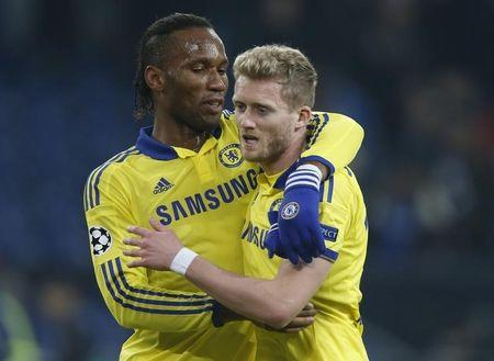 Chelsea's Drogba celebrates with Schuerrle after defeating Schalke 04 in Champions League match in Gelsenkirchen