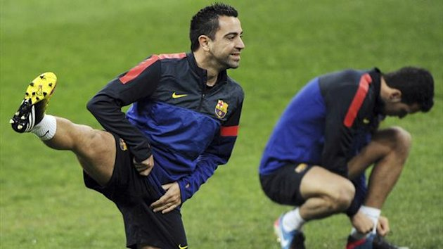 Barcelona's Xavi Hernandez warms up during a training session at the San Siro Stadium (Reuters)