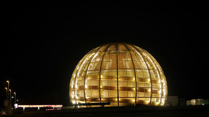 "FILE - In this March 30, 2010 file picture the globe of the European Organization for Nuclear Research, CERN, is illuminated outside Geneva, Switzerland. The world's largest and most powerful atom smasher goes into a 2-year hibernation in March 2013 , aiming to reach maximum energy levels that may lead to more stunning discoveries after hunting down the so-called ""God particle. But physicists at the European Center for Nuclear Research, known by its French acronym CERN, won't exactly be idle as the US $10 billion proton collider goes on hiatus for maintenance and retooling _ in preparation for unlocking more mysteries. There are still reams more data to sift through since the July 2012 discovery of a new subatomic particle called a Higgs boson and promises a new realm of understanding in subatomic science. (AP Photo/Anja Niedringhaus,File)"