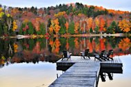 "This magnificent view shows the multihued beauty of the <a href=""http://www.ouramazingplanet.com/adirondack-lake-ecosystem-signs-of-recovery-0391/"">Adirondacks, a mountain range</a> located in the northeastern part of New York. In this region,"