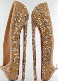 Christian Louboutin's ballet-inspired heels are eight inches tall. Photo courtesy of the Daily Mail.