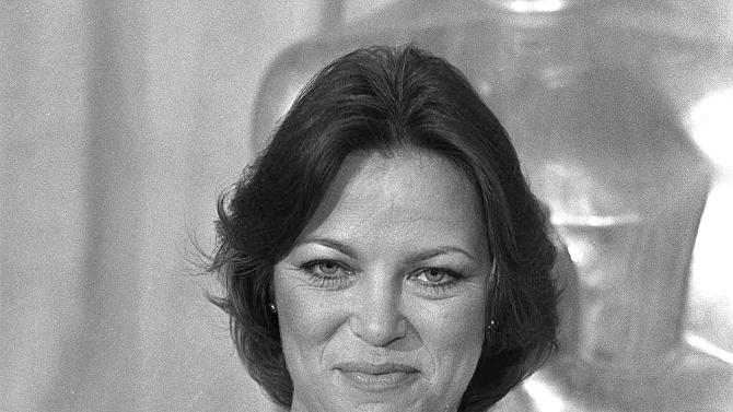 """File - In this March 29, 1976 file photo, actress Louise Fletcher holds the Oscar for """"Best Actress"""" which she won for her performance in """"One Flew Over The Cuckoo's Nest"""" at the Academy Awards in Los Angeles. Fletcher says she's no longer able to watch the movie """"One Flew Over the Cuckoo's Nest"""" because the character she won an Oscar for, Nurse Ratched, is so cruel. Fletcher will be in Salem, Ore., on Saturday, Oct. 6, 2012 for the opening of a museum of mental health at the rebuilt Oregon State Hospital, where the 1975 movie was filmed. (AP Photo/File)"""