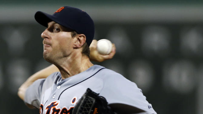 Detroit Tigers starting pitcher Max Scherzer delivers to the Boston Red Sox during the first inning of a baseball game at Fenway Park in Boston, Tuesday, Sept. 3, 2013. (AP Photo/Elise Amendola)