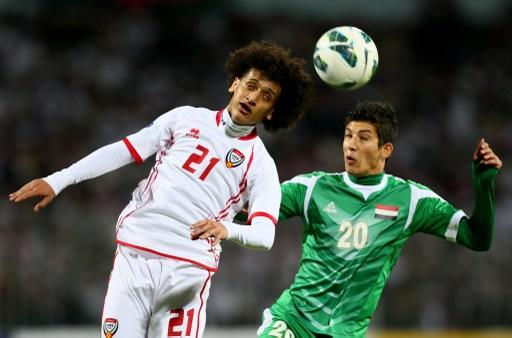 Dhurgham Ismael (R) of Iraq vies with Omar Abdelrahman of UAE as he attempts to score during the 21st Gulf Cup's final between United Arab Emirates (UAE) and Iraq on January 18, 2013 in Manama. United