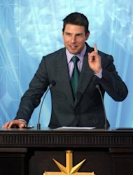 Tom Cruise, seen here speaking during the inauguration of the Church of Scientology in Madrid, in 2004. Citing unnamed sources, TMZ.com website claims Katie Holmes filed for divorce mainly over Cruise&#39;s ties to Scientology, &quot;fearing that Tom would drag Suri (their daughter) deep into the church.&quot;