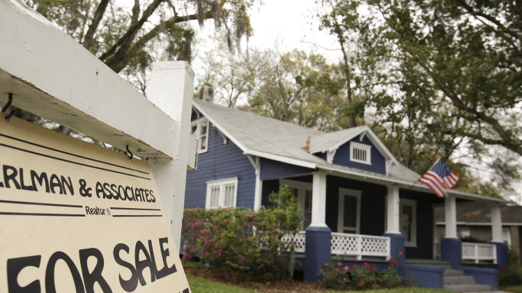 In this March 7, 2014 photo, a realty sign hangs in front of a home for sale in Orlando, Fla. Freddie Mac reports on average U.S. mortgage rates for the week on Thursday, April 17, 2014. (AP Photo/John Raoux, File)