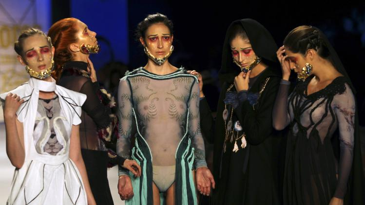Models present creations from Colegiatura University during Colombiamoda fashion show in Medellin