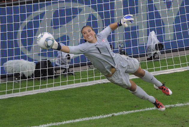United States goalkeeper Hope Solo deflects a penalty shot during the quarterfinal match between Brazil and the United States at the Womenís Soccer World Cup in Dresden, Germany, Sunday, July 10, 2011