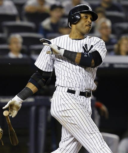 Cano powers Yankees to AL East title in 14-2 rout
