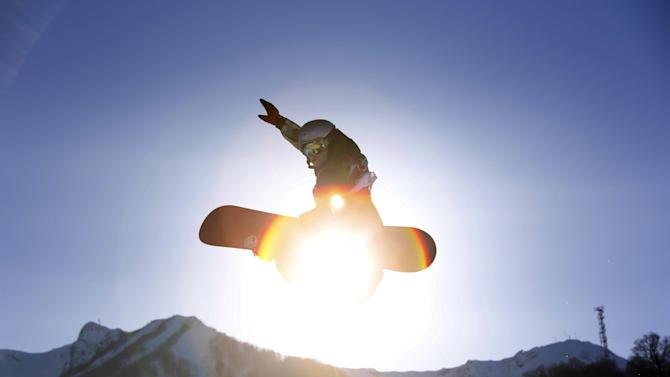 Czech Republic's Sarka Pancochova takes a jump during the women's snowboard slopestyle qualifying at the Rosa Khutor Extreme Park ahead of the 2014 Winter Olympics, Thursday, Feb. 6, 2014, in Krasnaya Polyana, Russia