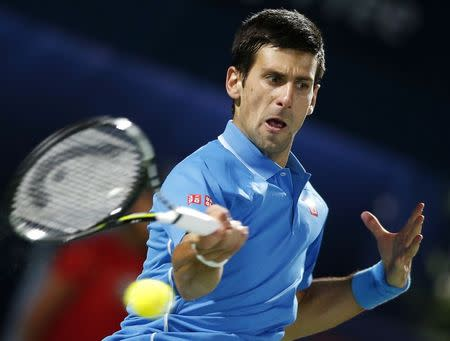 Djokovic of Serbia returns to Federer of Switzerland during their final match at the ATP Championships tennis tournament in Dubai