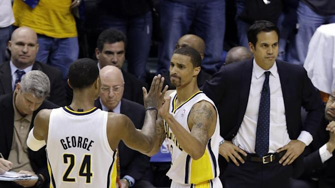 Indiana Pacers' Paul George (24) and George Hill react in front of Miami Heat head coach Erik Spoelstra, right, during the second half  Game 3 of the NBA Eastern Conference basketball finals in Indianapolis, Sunday, May 26, 2013. (AP Photo/Michael Conroy)
